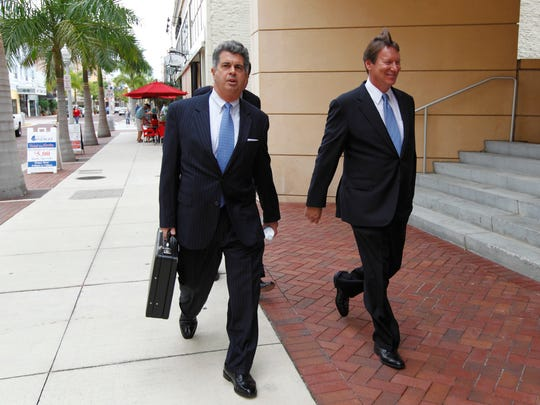 Former Orion Bank CEO Jerry Williams, right, walks to the federal courthouse on Friday, Feb. 3, 2012, in Fort Myers. Williams appeared at a hearing surrounding a plea deal he signed in December involving three counts of fraud at the bank.