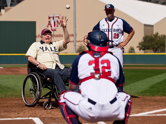 Former President George H. W. Bush throws out an opening pitch to Texas A&M player Stephen Kolek before a college baseball game between Texas A&M and Yale on Saturday, March 5, 2016, in College Station, Texas. (Timothy Hurst/College Station Eagle via AP) MANDATORY CREDIT