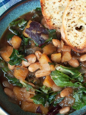Kale and bean soup is rich and flavorful. You also can add browned kielbasa.