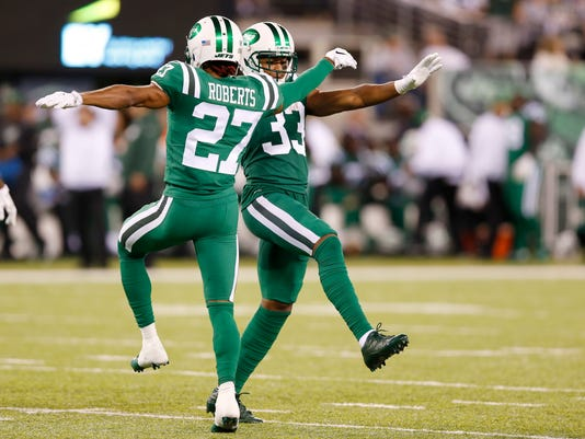 In this Thursday, Nov. 2, 2017, photo, New York Jets cornerback Darryl Roberts (27) and strong safety Jamal Adams (33) dance between plays during the second half of an NFL football game against the Buffalo Bills in East Rutherford, N.J. Playing under the bright lights of MetLife Stadium--just a few miles across the Hudson River from Broadway--Demario Davis, Adams, Darron Lee and the rest of the Jets' D shook off their previous fourth-quarter struggles with some serious dance moves. (AP Photo/Kathy Willens)