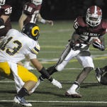 Kenosha Bradford's Melvin Gordon (right) dodges Marquette's Michael Trotter during a game at Indian Trail in 2009. Gordon now plays for the San Diego Chargers, and many other skill players in the state of Wisconsin are showing top-flight potential.