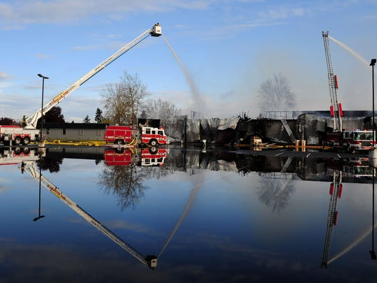 Fire crews work at the scene of a fire at South Albany High School, on Wednesday, April 1, 2015, in Albany. The cafeteria was the site of the fire.