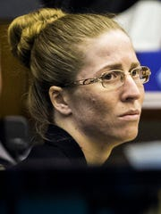 Lisa Troemner, 27, watches an evidence video during