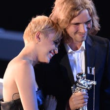 My Friend's Place representative Jesse (R) accepts Video of the Year with singer Miley Cyrus for 'Wrecking Ball' on stage at the MTV Video Music Awards (VMA), August 24, 2014 at The Forum in Inglewood, California.  AFP PHOTO / Robyn BeckROBYN BECK/AFP/Getty Images ORG XMIT: 503898889 ORIG FILE ID: 532717458
