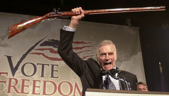 "Then-NRA president Charlton Heston delivers his famous ""cold, dead hands"" speech in 2002."