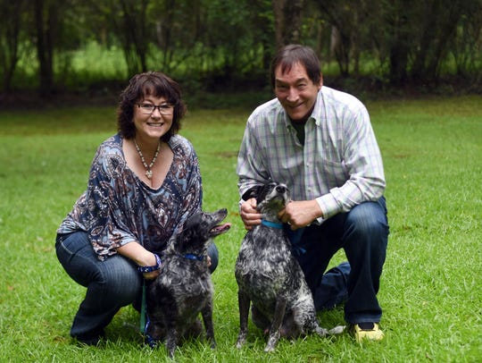 Tara and Randy Burcham are pictured with their dogs
