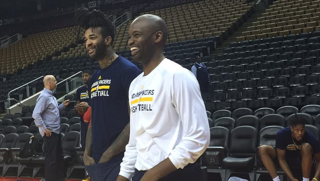 Pacers assistant video coordinator Jhared Simpson shares a light moment with Jordan Hill before the team's Sunday practice.