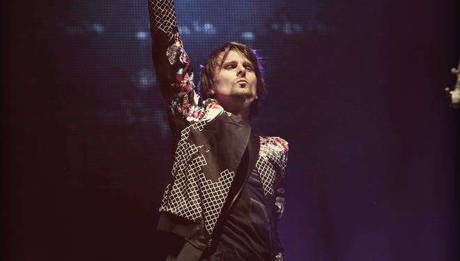 Musician Matthew Bellamy of Muse performs onstage during day 2 of the 2014 Coachella Valley Music & Arts Festival at the Empire Polo Club on April 12, 2014 in Indio, California.
