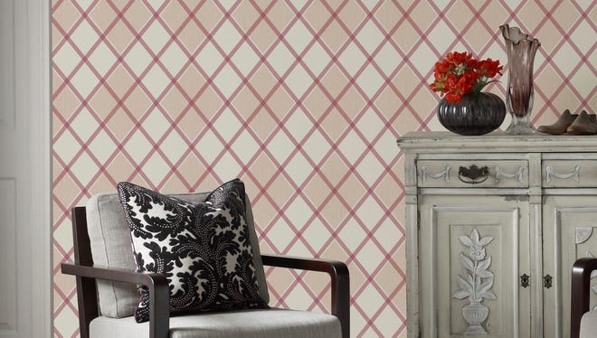 This photo provided by Allmodern.com shows Argyle wallpaper as an unexpected way to introduce a touch of Scottish flair to a space.
