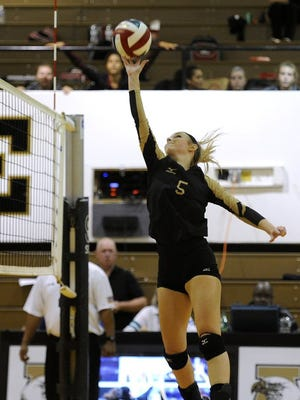 Thomas Metthe/Reporter-News Abilene High's Allison Pierce (5) tips the ball over the net during the second game of the Lady Eagles' loss toe Keller Central on Tuesday, Sept. 13, 2016, at Abilene High School.
