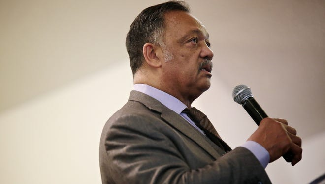 The Rev. Jesse Jackson, president of Rainbow PUSH Coalition, talks during the Rally For Justice at the Heavenly Host Gospel Baptist Church on Sunday in Flint.
