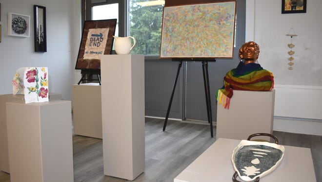 """A variety of artwork from across different mediums have been on display throughout this month at the Adrian Center for the Arts. The public exhibit titled """"While We Were Gone"""" features artwork by ACA member artists and inspired by the coronavirus pandemic shutdown."""