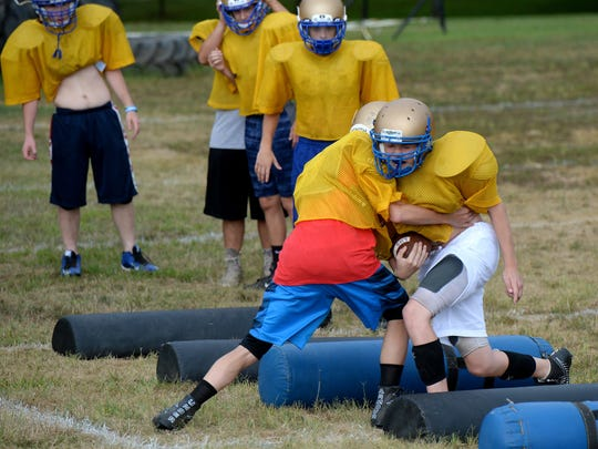 Lincoln High School football players practice Wednesday,