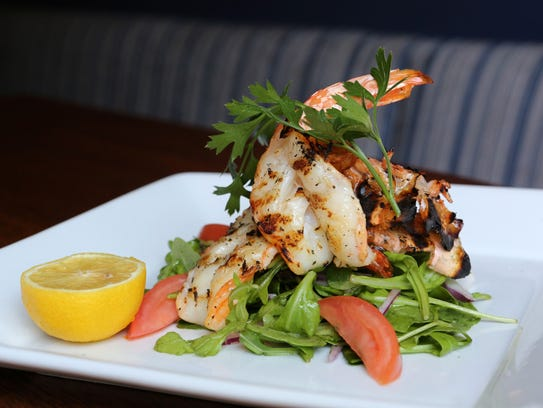 Grilled Jumbo shrimp served over arugula, tomato and