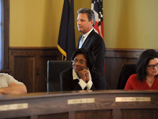 BWL General Manager J. Peter Lark walks past BWL commisioners Cynthia Ward and Margaret A. Bossenbery before commisioners voted 5-3 to fire him on Jan. 13.