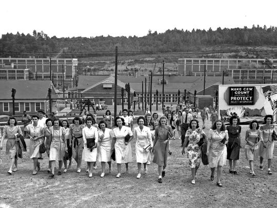 """A shift change for Manhattan Project workers at Y-12 in Oak Ridge. Some 22,482 people worked at the Y-12 plant, the world's first uranium enriching facility. It produced the first U-235 fuel for """"Little Boy,"""" the bomb dropped on Hiroshima. (ED WESTCOTT/DEPARTMENT OF ENERGY)"""