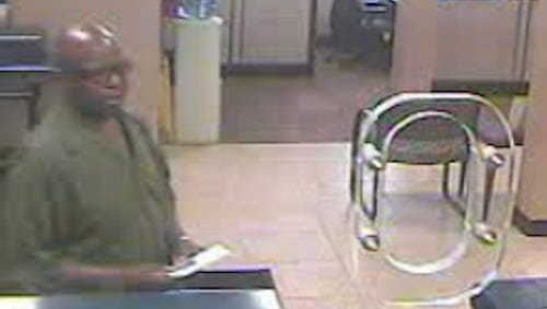New York state police released this bank surveillance photo of a man they want to question in an identity-theft investigation in the Cortlandt area, Sept. 22, 2014.