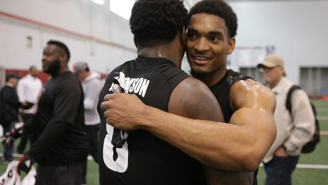 Former teammates Lamar Jackson and Reggie Bonnafon hugged after completing their NFL Pro Day workouts. March 30, 2018.