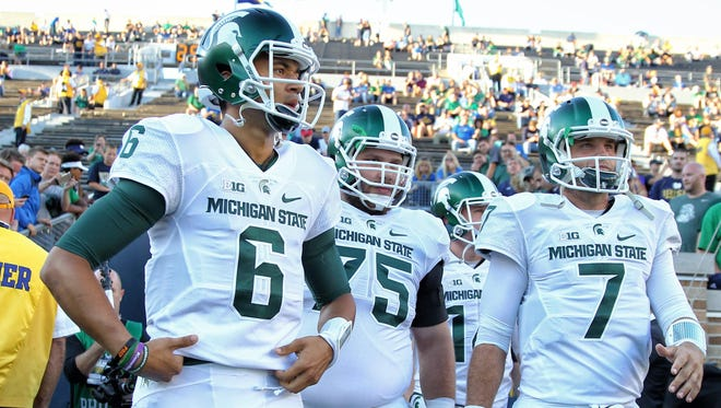MSU junior Damion Terry (6) quarterback spelled starting quarterback Tyler O'Connor (7) twice at Notre Dame, but he did not play against Wisconsin.