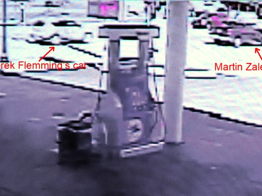 This photograph is a moment captured by gas station surveillance video on Sept. 2 as Martin Zale's Dodge Ram pickup speeds ahead of Derek Flemming's silver Ford Escape on Grand River Avenue. Their encounter ended at the Chilson Road intersection in Genoa Township when Zale fatally shot Flemming when the man approached his window. Zale's murder trial continues today in Livingston County Circuit Court.