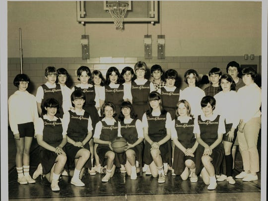 The 1968 Queen of Heaven girls basketball team poses for a photo.