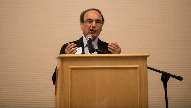 Dr. Sajjad Iqbal, retired Ridgewood pediatrician of 30 years, holds a book signing and launch of his newly published book: Swimming Upstream at the Ridgewood Public Library on Saturday, April 15, 2017. Iqbal reads a passage from his book.