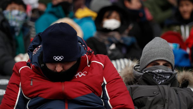 Spectators brave the cold weather while waiting for the start of the women's slopestyle qualifications at Phoenix Snow Park at the 2018 Winter Olympics on Sunday in Pyeongchang, South Korea.