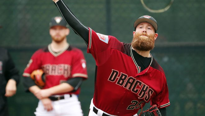 Arizona Diamondbacks relief pitcher Archie Bradley (25) throws during the first day of workouts for pitchers and catchers at Salt River Fields on the Salt River Pima-Maricopa Indian Reservation.