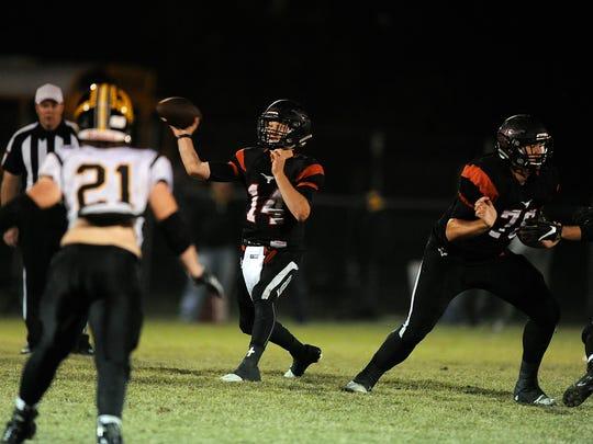 Eastland quarterback Mason Wright (14) throws a pass