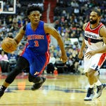 Mar 14, 2016; Washington, DC, USA; Detroit Pistons forward Stanley Johnson (3) dribbles the ball past Washington Wizards guard Alan Anderson (6) during the first half at Verizon Center.