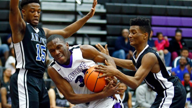 Cane Ridge's Howard Jonathon (3) battles for the ball with Antioch's Jaylan Morgan (10) and Ronkerion Williamson during their game Friday.