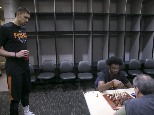 Alex Len looks on as Josh Jackson plays a chess match