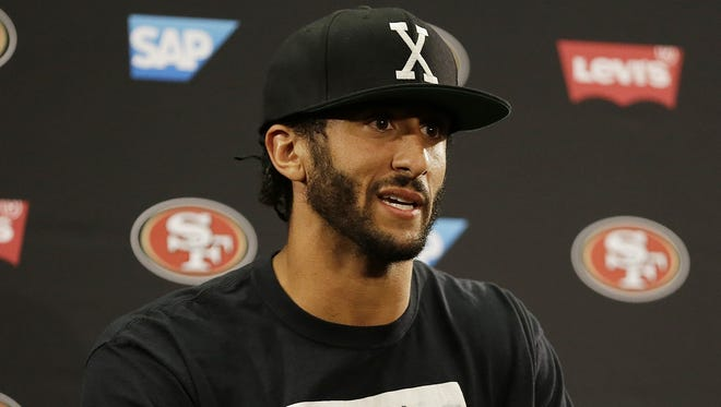 San Francisco 49ers quarterback Colin Kaepernick answers questions at a news conference after an NFL preseason football game against the Green Bay Packers last Friday.
