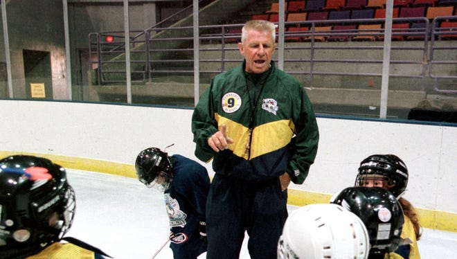In this 1999 photo, former Pensacola Ice Pilots assistant coach George Kozak talks with youths at the Pensacola Bay Center during a learn-to-play hockey clinic. Kozak, a beloved part of the Ice Pilots history, passed away Sunday.