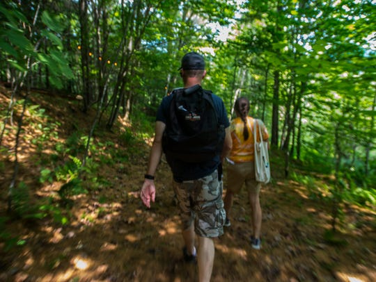 Patrons make their way down a trail to the Heady Vermont