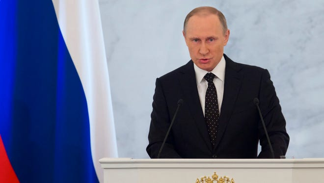 Russian President Vladimir Putin gives his annual state of the nation address in the Kremlin in Moscow on Dec. 3, 2015.