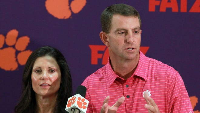 Clemson coach Dabo Swinney and wife Kathleen announced Tuesday they're giving $1 million to IPTAY to help the football program.