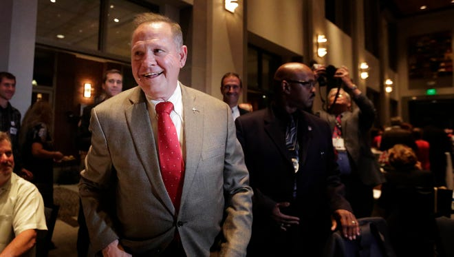 In this Sept. 26, 2017, file photo, Senate candidate Roy Moore greets supporters before his election party in Montgomery, Ala.