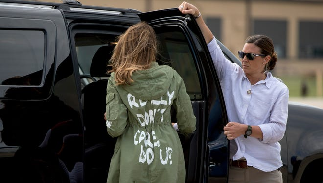 At the end of her journey photographers get a fuller view of Melania Trump's jacket as she  arrives back at Andrews Air Force Base, Md., after visiting the Upbring New Hope Children Center run by the Lutheran Social Services of the South in McAllen, Texas.  The jacket by Zara  reads 'I really don't care do U?'