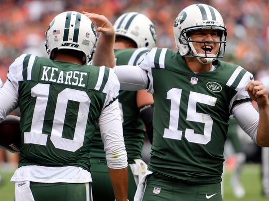 FILE - In this Oct. 8, 2017, file photo, New York Jets quarterback Josh McCown (15) and wide receiver Jermaine Kearse celebrate touchdown during an NFL football game against the Cleveland Browns in Cleveland. The Jets are 4-6 and have already won more games than most anyone expected. That's good news to some and bad news to others. (AP Photo/David Richard, File)