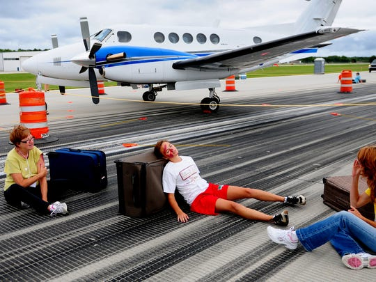 Volunteers portray victims of a plane crash during the airport emergency management drill at Austin Straubel International Airport, Wednesday, August 20, 2014.