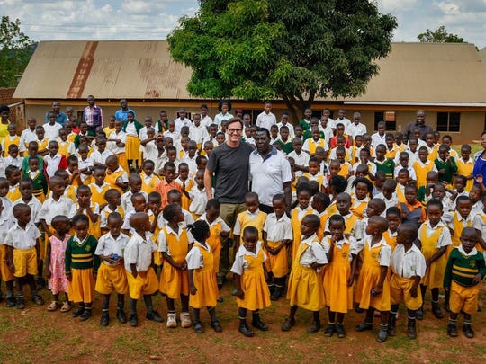 Jim Koenigsaecker provided this photo of him (center) with staff and students of God is Good school in Keybando, Uganda.