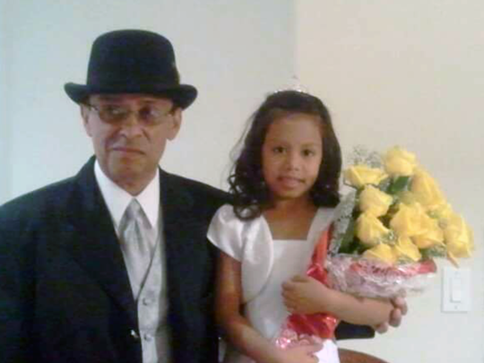 David Bustillos with his granddaughter before her first