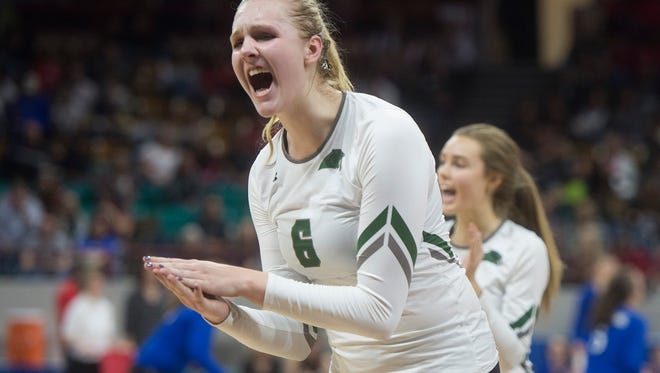 Riley Zuhn of Fossil Ridge celebrates after a play during the CHSAA 5A State Semifinals against Denver East at Denver Coliseum on Friday, November 10, 2017. The SaberCats were defeated by the Denver East Angels in three sets.