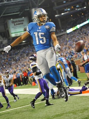 Golden Tate leaps into the end zone with his second-quarter TD.