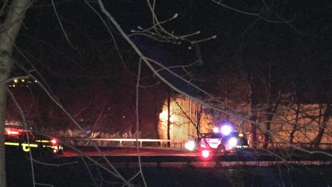 Police lights and flares can be seen  near a wrong-way crash Monday night on Route 9 in Peekskill.