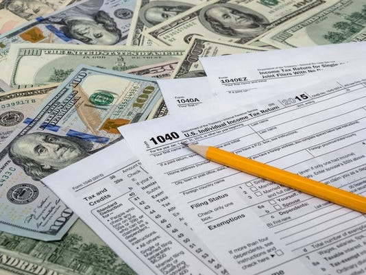 tax-forms-for-lower-your-taxes_gettyimages-507839992_large.jpg