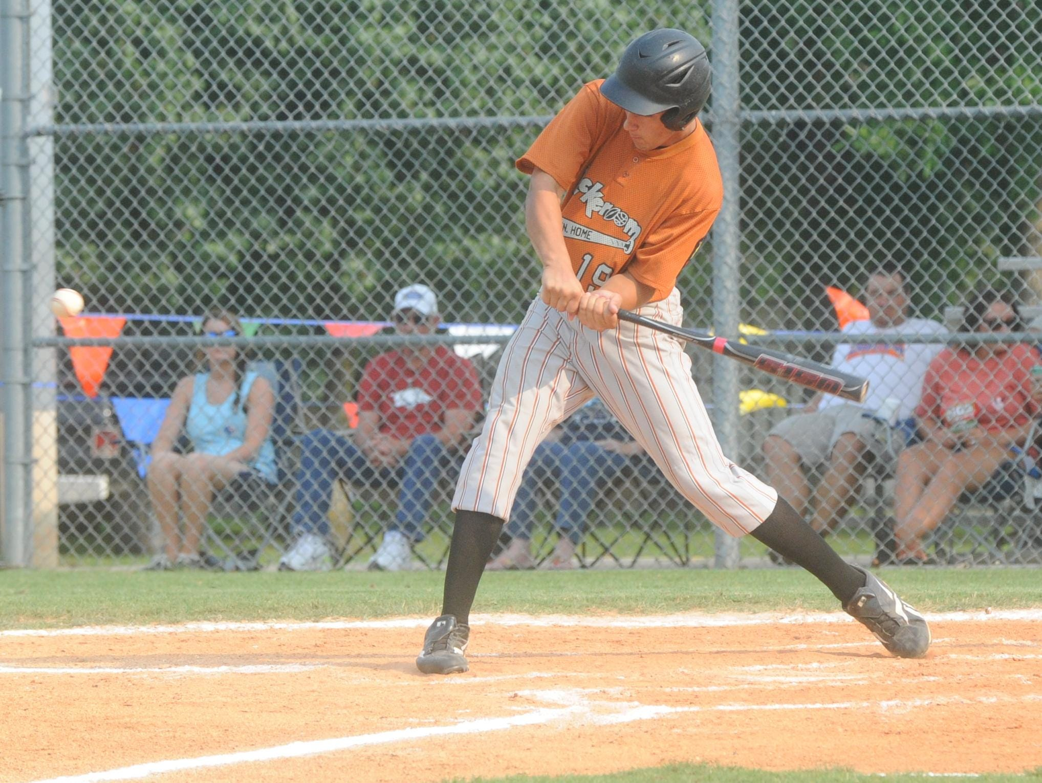 Lockeroom's Jake Berton swings at a pitch during the first game of Mountain Home's doubleheader sweep of Batesville on Tuesday night at Cooper Park.