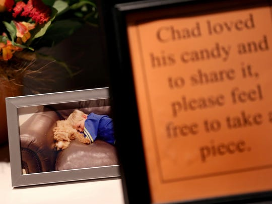 A photo of Chad Carr sat a table with a basket of candy during the visitation and memorial service.