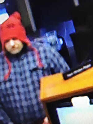 Surveillance video image of a man police are looking for in the investigation of a Friday morning bank robbery at First Tennessee Bank on North Highland Avenue.